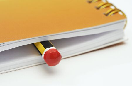 memento: pencil inside a notebook Stock Photo