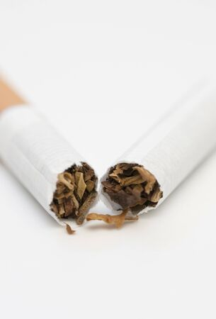 quiting smoking: broken cigarette on white background