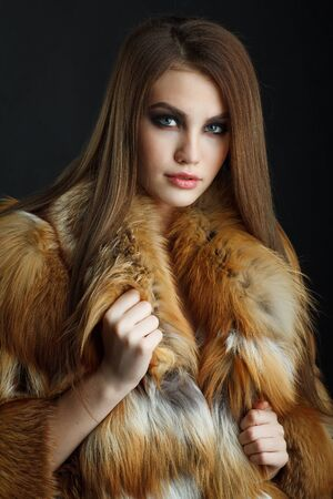 cold woman: Beauty Fashion Model Girl in  fox Fur Coat. Stock Photo