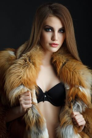 sexy fur: Beauty Fashion Model Girl in  fox Fur Coat. Stock Photo