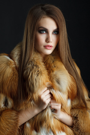 Beauty Fashion Model Girl in  fox Fur Coat. Stock fotó