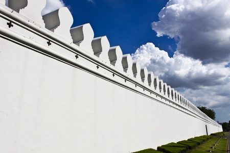 wall of temple in thailand with sky photo