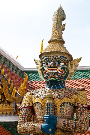 Ancient giant sculpture of The Emerald Buddha temple in Bangkok, Thailand.