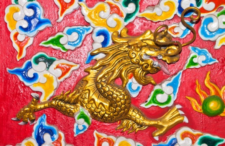 Dragon sculpture on wall of temple.