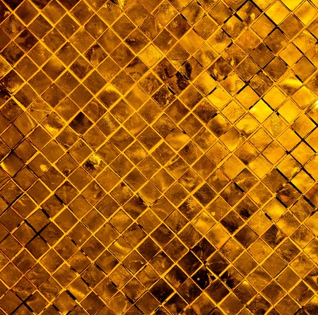 gold abstract background from tile mosaic photo