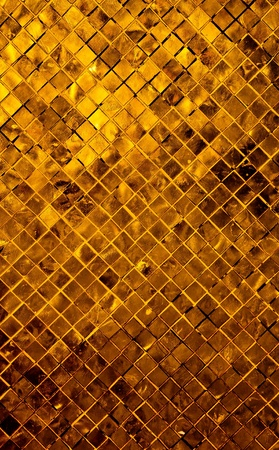 grunge gold abstract background from tile mosaic  photo