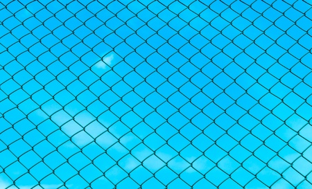 chain fence with blue sky on the back  photo