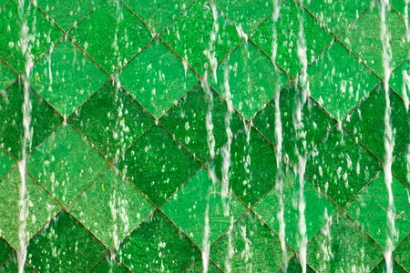 Tile surface with water flowing through  photo