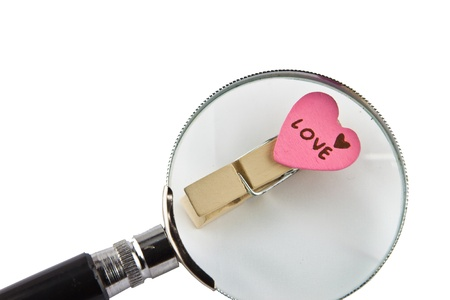 Love word and magnifying glass Image photo