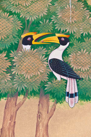 Great Hornbill vintage painting from temple thailand,  The site is open to the public and photography is permitted   Stock Photo