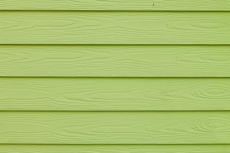 Texture of light green color paint plank wall for background  photo