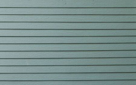 Texture of green color paint plank wall for background