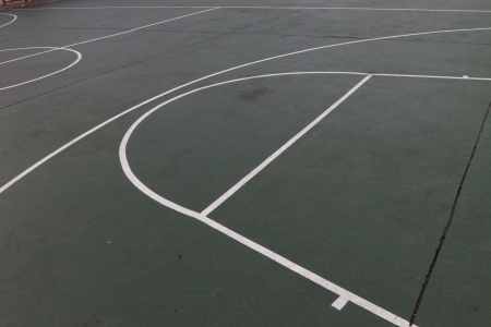 Outdoor green and white basketball court background