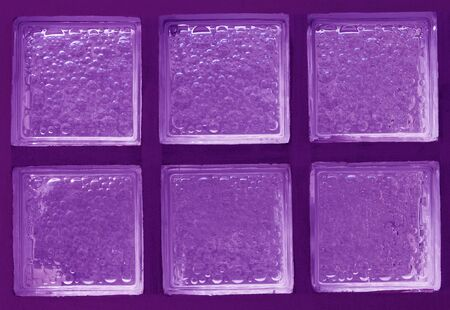 Abstract of a Purple-tone Glass Block Window  photo
