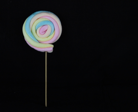 Colorful candy on black background  photo