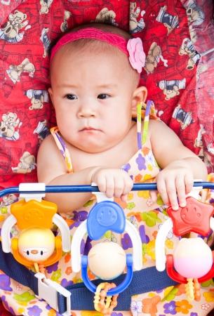Baby in sitting stroller photo