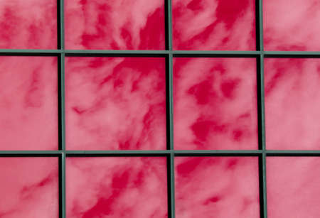 Abstract Cloudy sky reflected in the glass wall photo