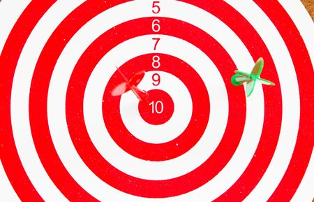dart board with darts  photo