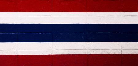 Thailand flag painted on brick wall texture background photo