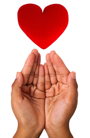 Conceptual symbol of love with hand and heart isolated on white background photo