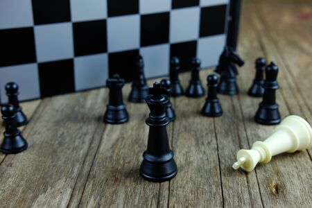 Close up of chess with black king on board. Business concept able to survive or dominant from competition to victory. Selective focus.