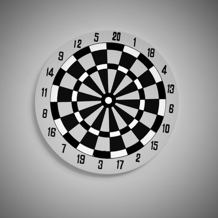 background texture metaphor: Top view of Target dart board, black and white tone, vignette effect. Business and education concept metaphor to target is to expect, copy space and selective focus.