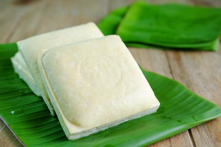 Healthy of Tofu on banana leaf on wooden background, vegetarian food, selective focus. 版權商用圖片