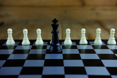 Close up of chess with black king on board. Business concept able to survive or dominant from competition, leadership, selective focus. Stock Photo
