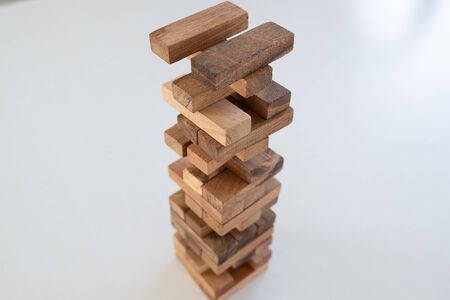 blocks wood game, gambling placing wooden block. Concept Risk of management and strategy plan, growth business success process Standard-Bild