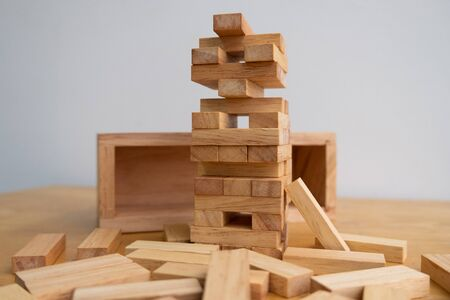 Wood block tower with architecture model, Concept Risk of management and strategy plan, growth business success process and team work. Stock fotó
