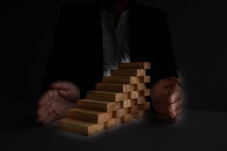 Hand provent blocks wood game, Concept Risk of management and strategy plan, growth business success process and team work.