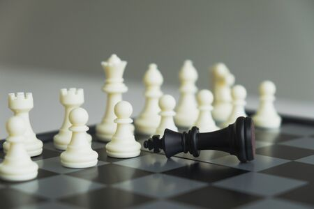 The chess board shows leadership, followers and business success strategies.