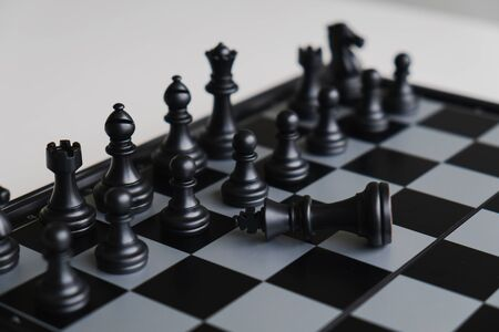 The chess board shows leadership, followers and business success strategies. Leaders must be humble. 写真素材