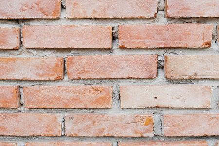 Close up photo of a red brick wall background.