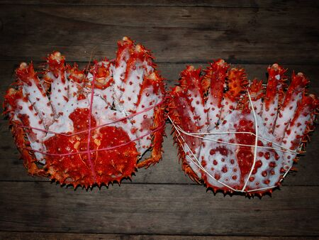 king crab Alaska frozen ready on wood table for cooking.