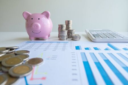 Pink piggy bank with coins pile  graph and calculator, step up growing business to success and saving for retirement  concept.