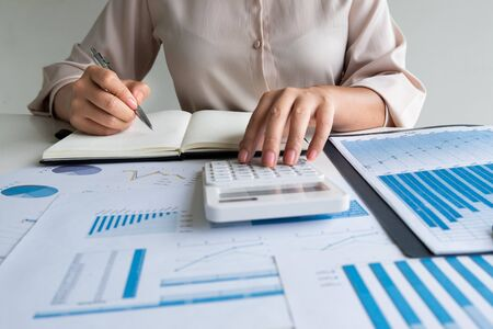 business leader woman analyzing the charts and graphs for planning management new project.