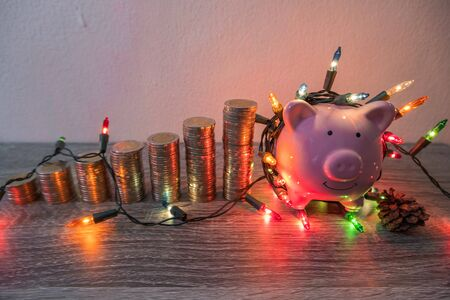 Pink piggy bank with party light, organize a party for the event where successful in saving money for use in various festivals.