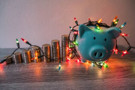 blue piggy bank with party light, planning a party for the event where successful in saving money for use in various festivals.
