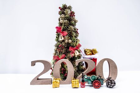 Beautifully decorated Christmas tree with a holiday party beginning in the new year and crossing to year 2020.