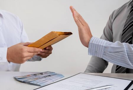 The businessman denies the money in envelope proposed by his partner to bribe the concept of bribery and corruption. 스톡 콘텐츠