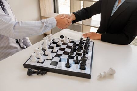 Businessmen shake hands after the competition, showing leadership, followers and business success strategies.