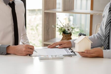 Real estate agent broker with home insurance forms In order for the customer to sign the contract according to the agreement buying home insurance officially Home insurance concept.