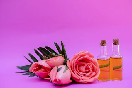 Essential oil in bottles extracted from rose.