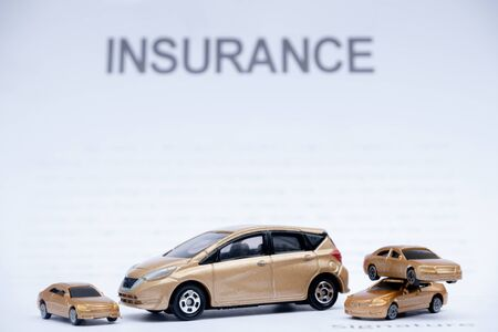 Car placed on insurance documents. Car insurance concept.