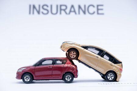 Car placed on insurance documents. Car insurance concept. Reklamní fotografie