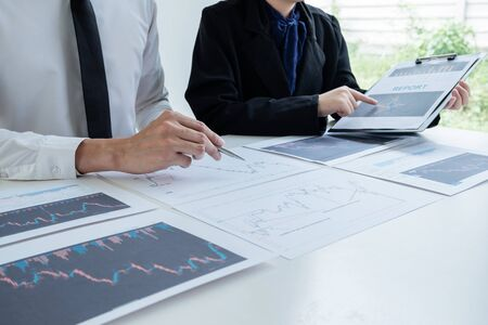 A team of business executives are planning consultations about business investments related to shares. By analyzing and calculating the stock market to find marketing profits. Stock fotó