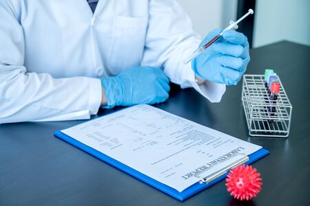 Professional doctors perform find virus tests from samples of blood tests to diagnose coronary virus infections analysis and sampling of infectious.