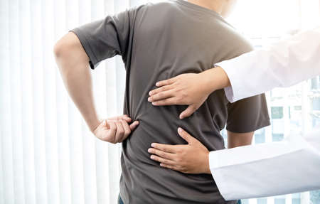 Male patients consulted physiotherapists with Low back pain for examination and treatment. Rehabilitation physiotherapy concept.