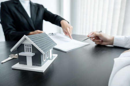 Real estate agents have a rental contract form for customers to sign a contract by the formal rental agreement Rental and insurance concepts.
